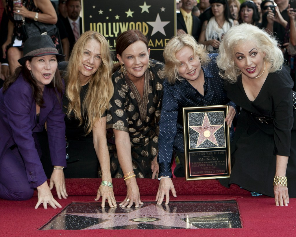FILE - The female band The Go-Go's, from left, Kathy Valentine, Charlotte Caffey, Belinda Carlisle, Gina Schock and Jane Wiedlin pose at their star on...