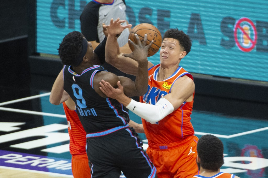 Sacramento Kings guard Terence Davis (9) is fouled by Oklahoma City Thunder center Isaiah Roby during the first quarter of an NBA basketball game in S...