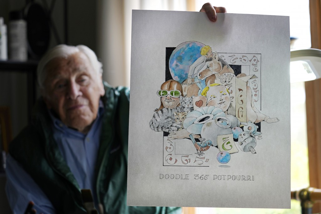 Artist Robert Seaman holds up the 365th daily doodle sketch in his room at an assisted living facility Monday, May 10, 2021, in Westmoreland, N.H. Sea...