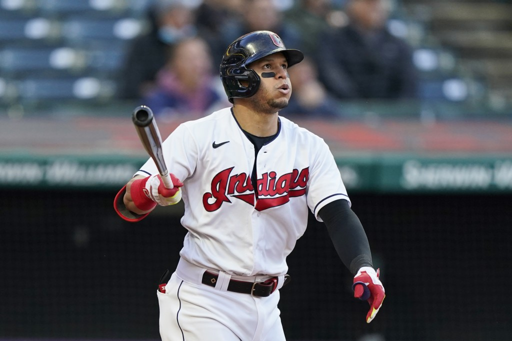 Cleveland Indians' Cesar Hernandez watches his ball after hitting a two-run home run in the fifth inning of a baseball game against the Chicago Cubs, ...