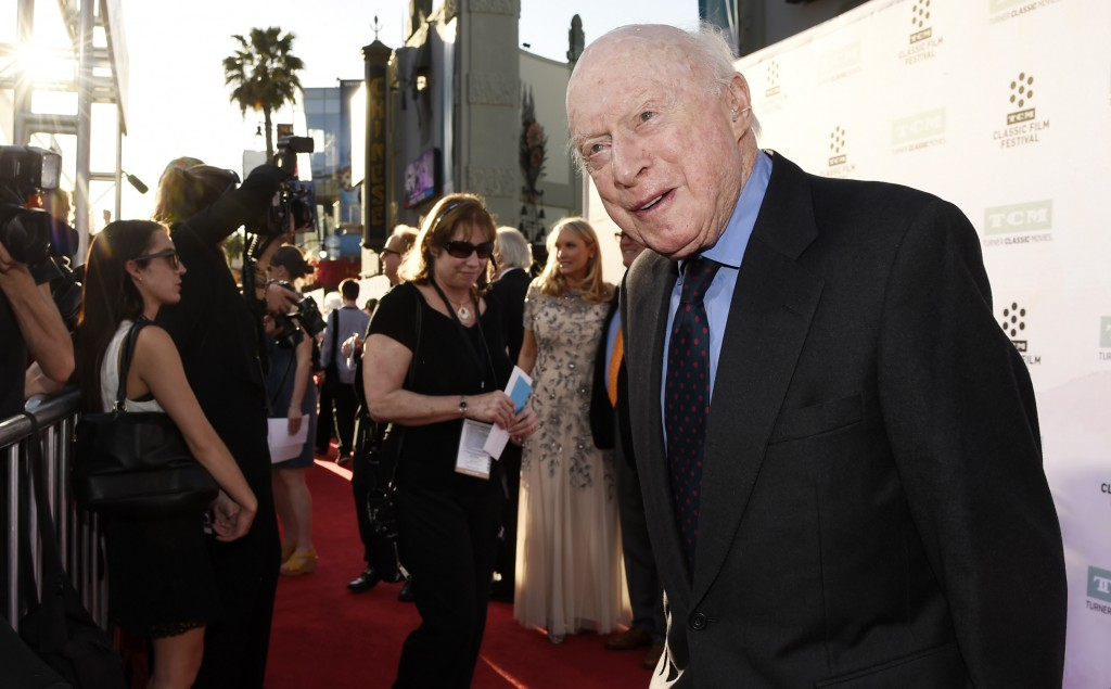 """FILE - Norman Lloyd poses before a 50th anniversary screening of the film """"The Sound of Music"""" at the opening night gala of the TCM Classic Film Festi..."""