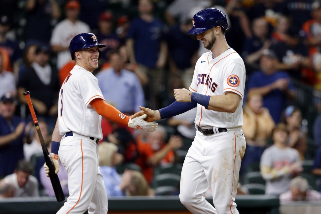 Houston Astros' fielder Myles Straw, left, and Kyle Tucker, right, celebrate Tucker's home run during the fifth inning of a baseball game against the ...
