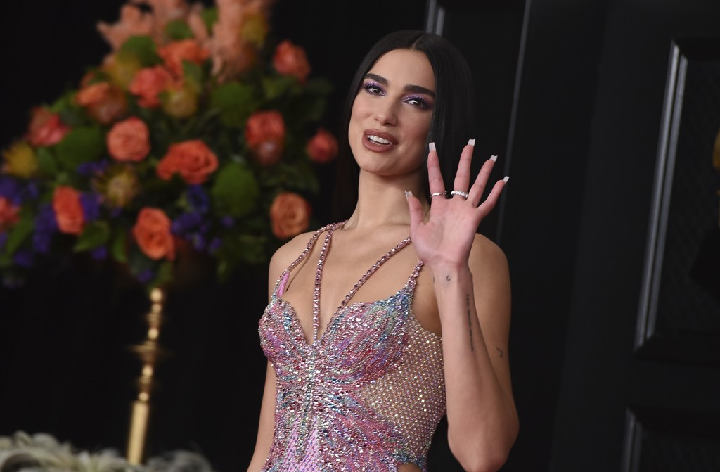 FILE - In this Sunday, March 14, 2021 file photo, Dua Lipa arrives at the 63rd annual Grammy Awards at the Los Angeles Convention Center. British musi...