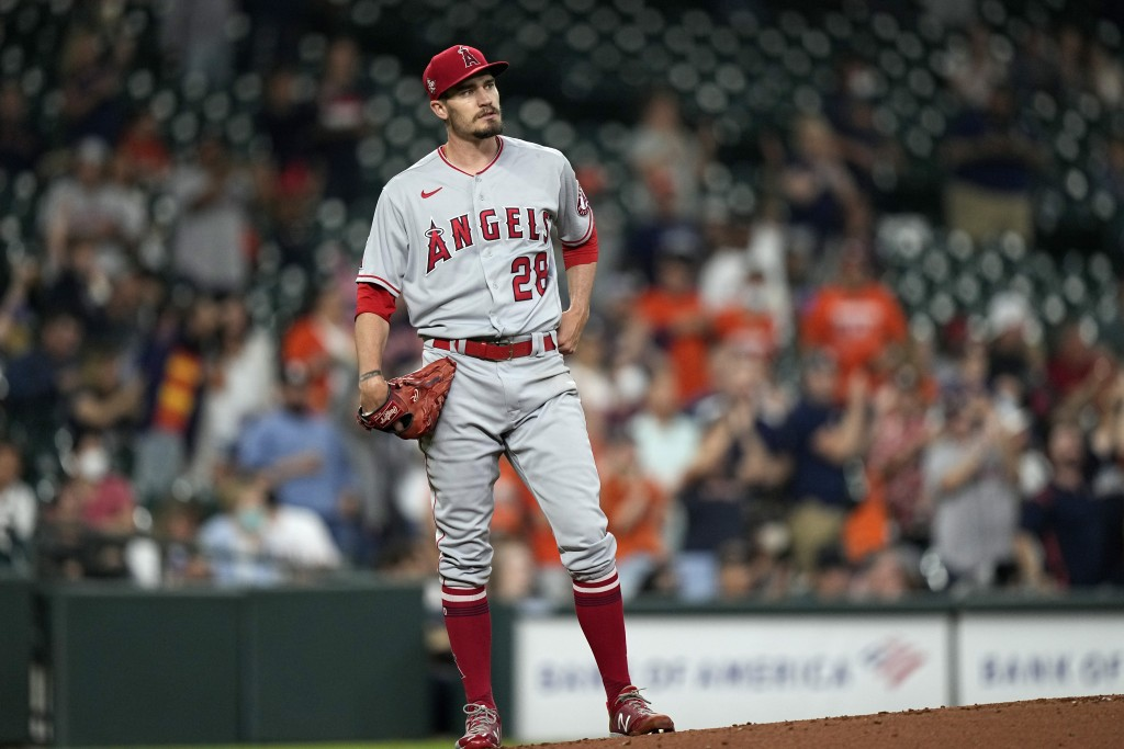 Los Angeles Angels starting pitcher Andrew Heaney (28) watches Houston Astros' Yuli Gurriel's two-run home run during the first inning of a baseball g...