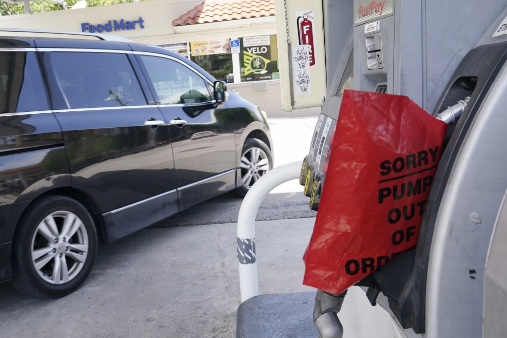A customer drives from a Chevron station after it ran out of gasoline, Wednesday, May 12, 2021, in Miami. State and federal officials are scrambling t...