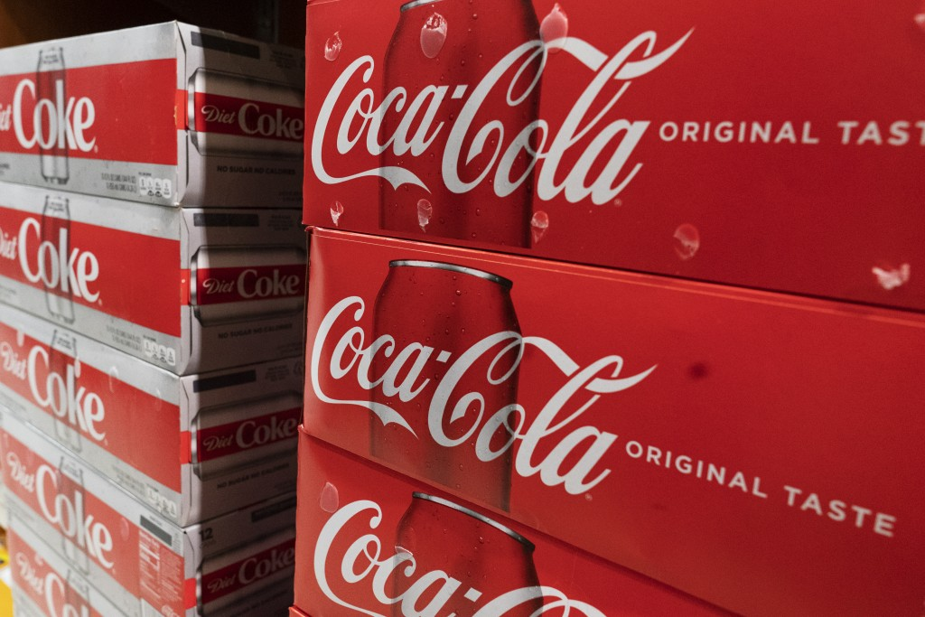 Cases of Coca-Cola are displayed in a supermarket, Monday, April 5, 2021 in New York. Rising prices for a variety of commodities are contributing to a...