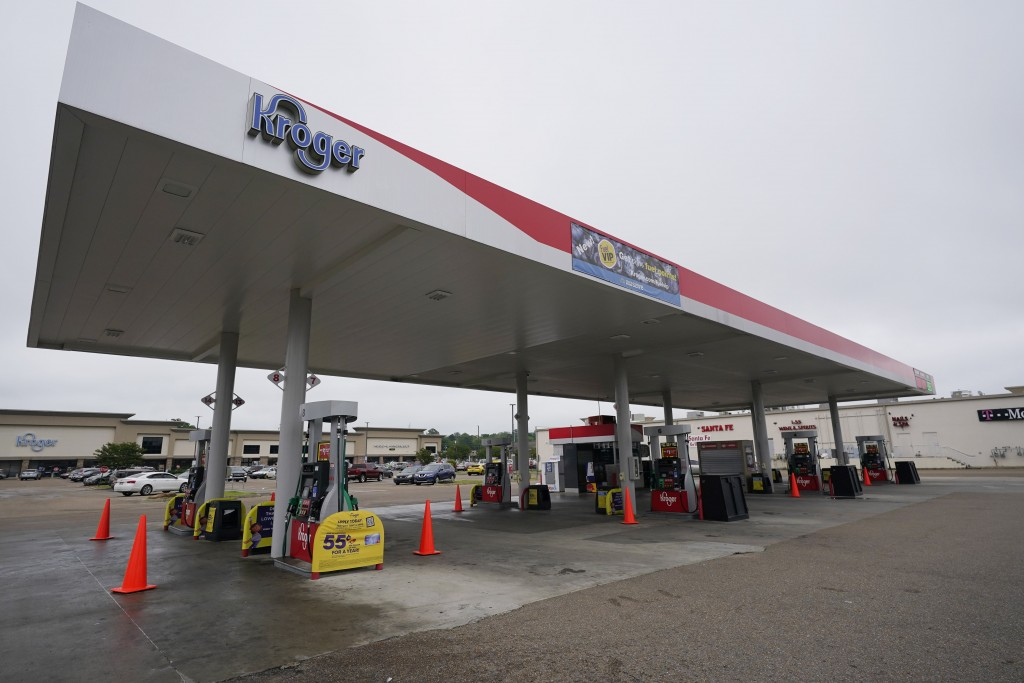 Safety cones block access to the fuel pumps at this closed Kroger fuel station, Wednesday, May 12, 2021, in Jackson, Miss. State officials warned Tues...
