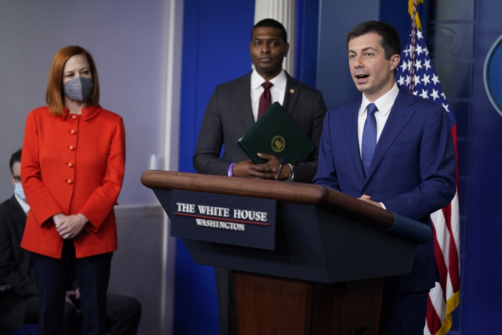 Secretary of Transportation Secretary Pete Buttigieg listens during a press briefing at the White House, Wednesday, May 12, 2021, in Washington. White...