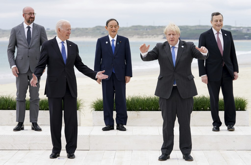 Leaders of the G7 pose during a group photo at the G7 meeting at the Carbis Bay Hotel in Carbis Bay, St. Ives, Cornwall, England, Friday, June 11, 202...