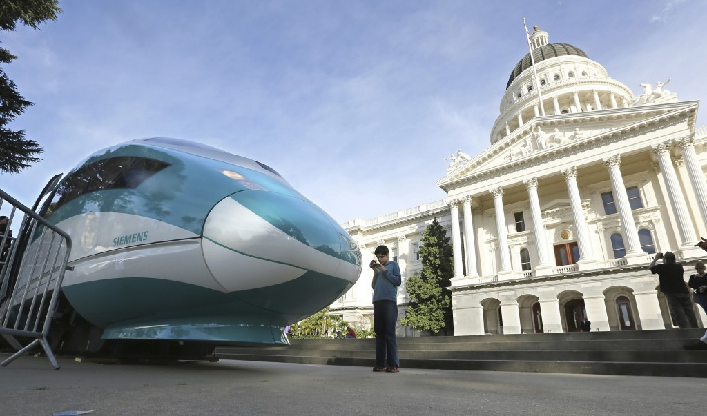FILE - In this Feb. 26, 2015, file photo, a full-scale mock-up of a high-speed train is displayed at the Capitol in Sacramento, Calif. The federal gov...