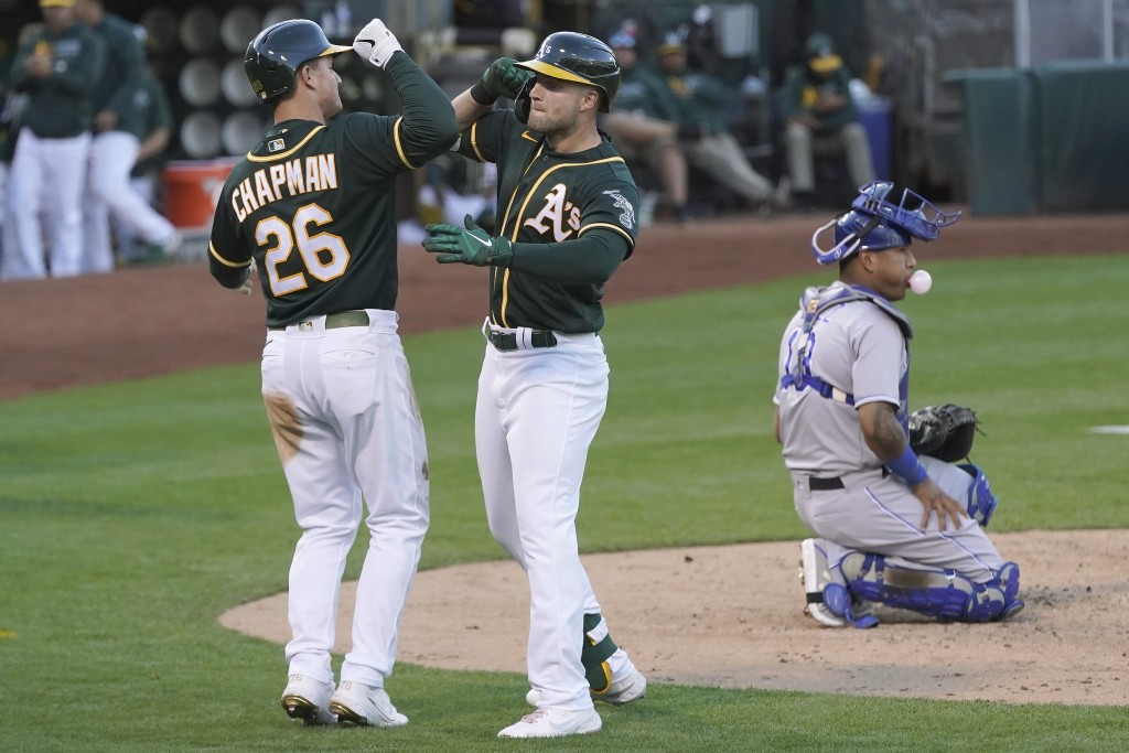 Oakland Athletics' Seth Brown, center, celebrates after hitting a two-run home run that also scored Matt Chapman (26) during the fourth inning of a ba...