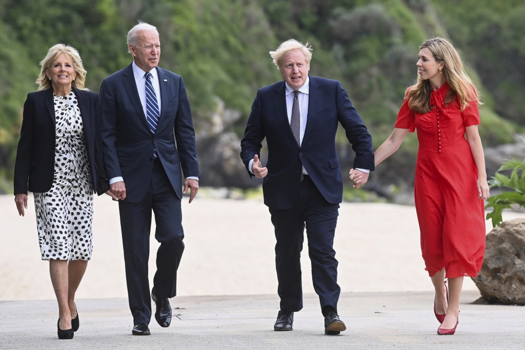Britain's Prime Minister Boris Johnson, his wife Carrie Johnson and U.S. President Joe Biden with first lady Jill Biden walk outside Carbis Bay Hotel,...