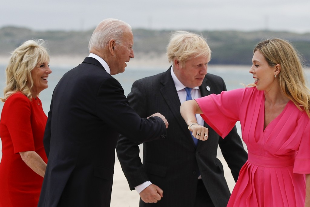 Britain's Prime Minister Boris Johnson and his spouse Carrie Johnson greet U.S. President Joe Biden and first lady Jill Biden during arrivals for a G7...