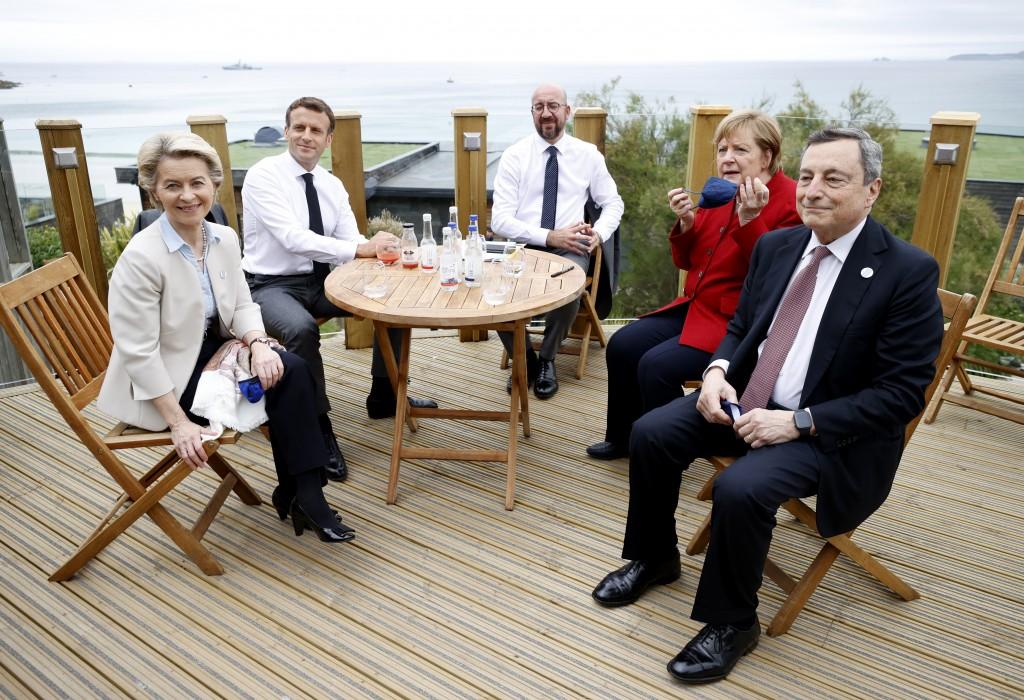 From left, European Commission President Ursula von der Leyen, French President Emmanuel Macron, European Council President Charles Michel, German Cha...