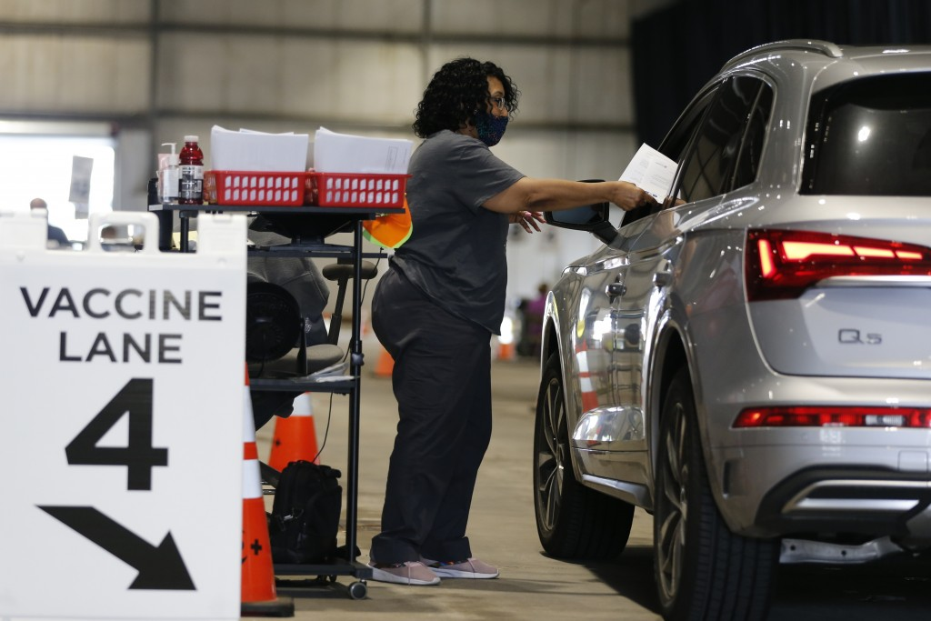 Judy Shavers administers a coronavirus vaccine at the drive-thru clinic Thursday, June 10, 2021, in Columbus, Ohio. The U.S. is confronted with an eve...