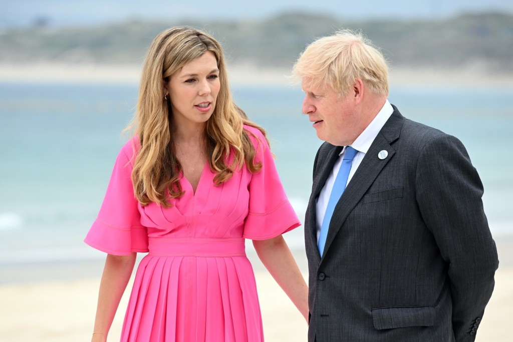 Britain's Prime Minister Boris Johnson and wife Carrie Johnson arrive for the Leaders official welcome and family photo during the G7 Summit In Carbis...