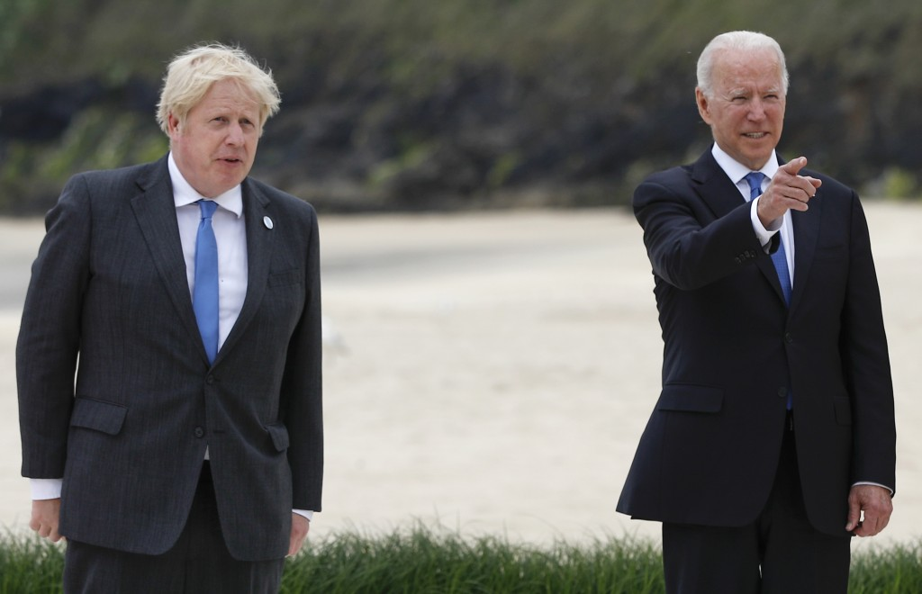 Britain's Prime Minister Boris Johnson poses with U.S. President Joe Biden during arrivals for a G7 meeting at the Carbis Bay Hotel in Carbis Bay, St....