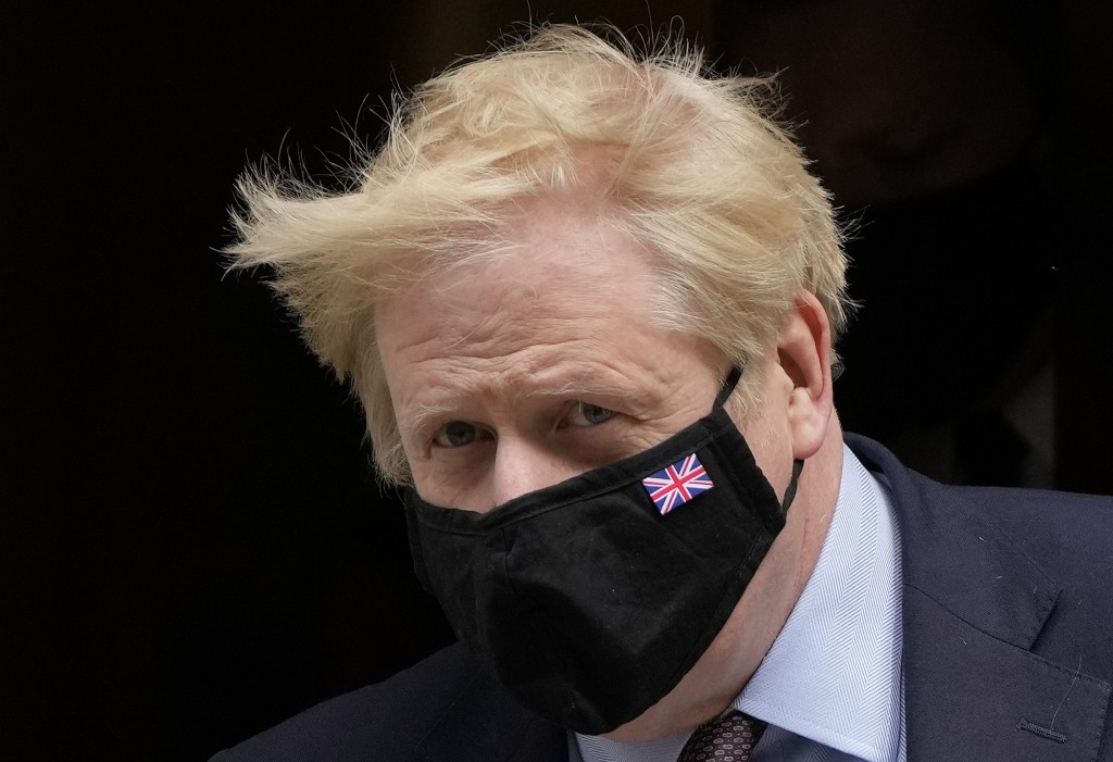 FILE - In this May 26, 2021, file photo, Britain's Prime Minister Boris Johnson leaves 10 Downing Street to attend the weekly Prime Ministers' Questio...