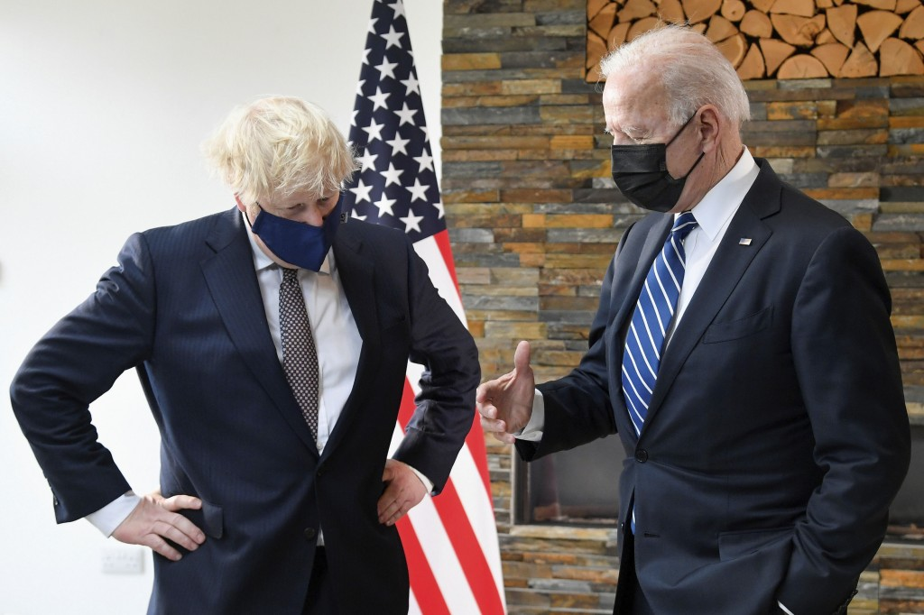US President Joe Biden, right, talks with Britain's Prime Minister Boris Johnson, during their meeting ahead of the G7 summit in Cornwall, Britain, Th...