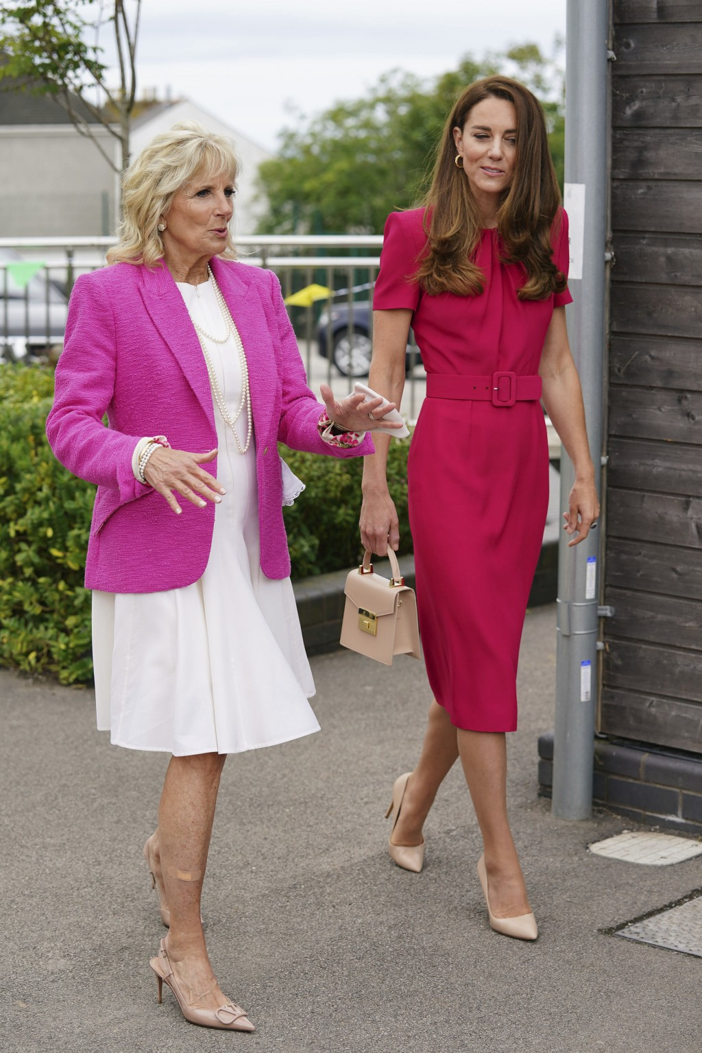 Britain's Kate, Duchess of Cambridge, right, and US First Lady Jill Biden during a visit to Connor Downs Academy in Hayle, West Cornwall, during the G...