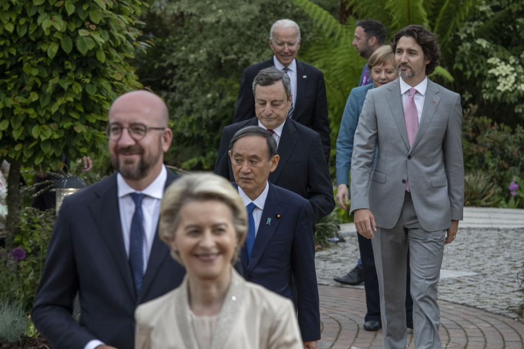 US President Joe Biden, bckground centre and other leaders walk to take a group photo, during a reception for the G7 leaders at the Eden Project in Co...