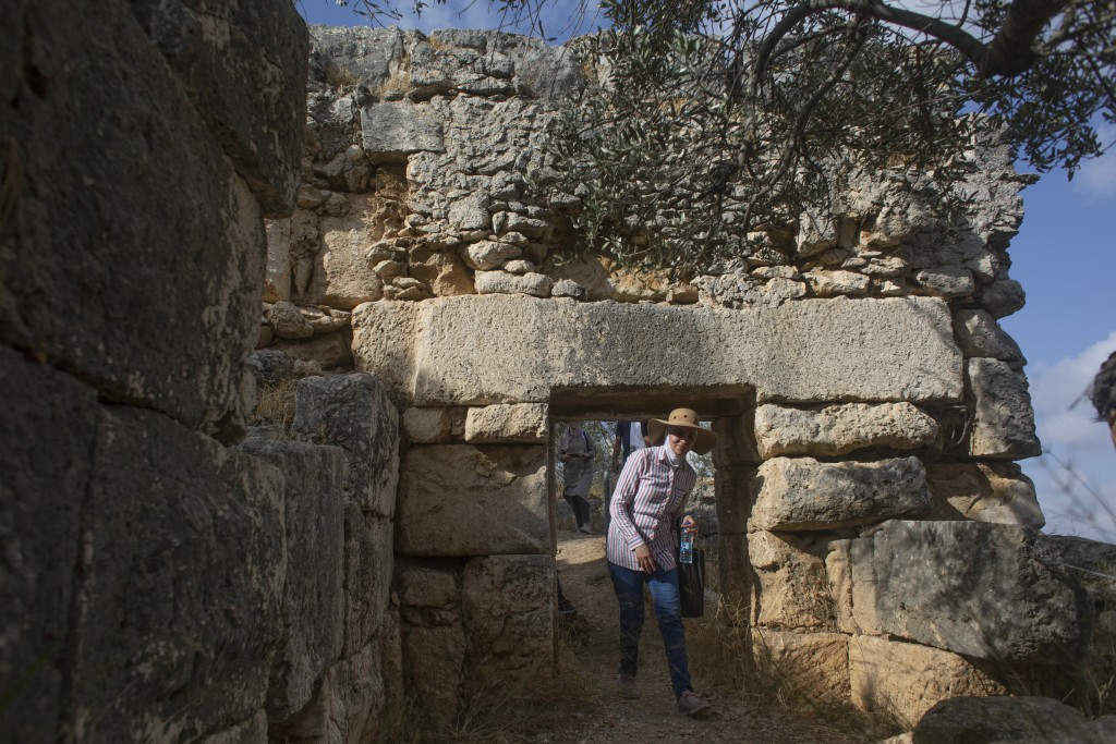"""Hikers explore Deir Qalaa, """"Monastery of the Castle,"""" the remains of a Byzantine monastery near the Jewish settlement of Peduel and the Palestinian vi..."""