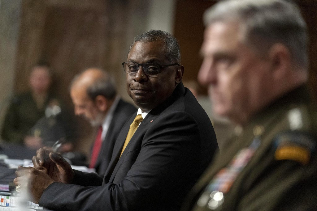 Secretary of Defense Lloyd Austin, center, Chairman of the Joint Chiefs of Staff Gen. Mark Milley, right, and Defense Under Secretary Mike McCord, lef...