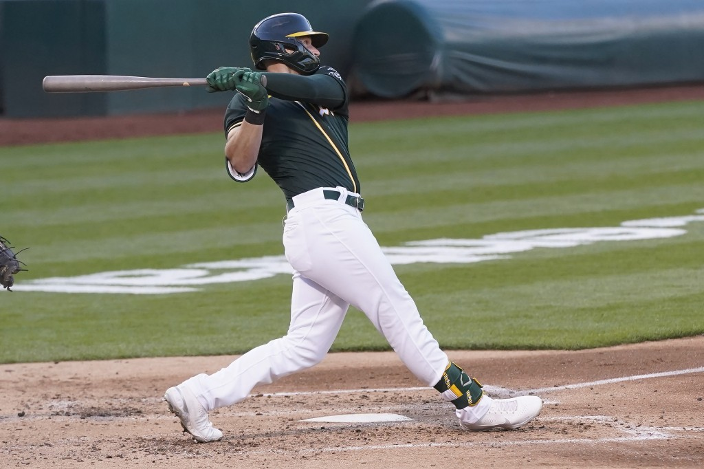 Oakland Athletics' Seth Brown hits a two-run home run against the Kansas City Royals during the fourth inning of a baseball game in Oakland, Calif., F...