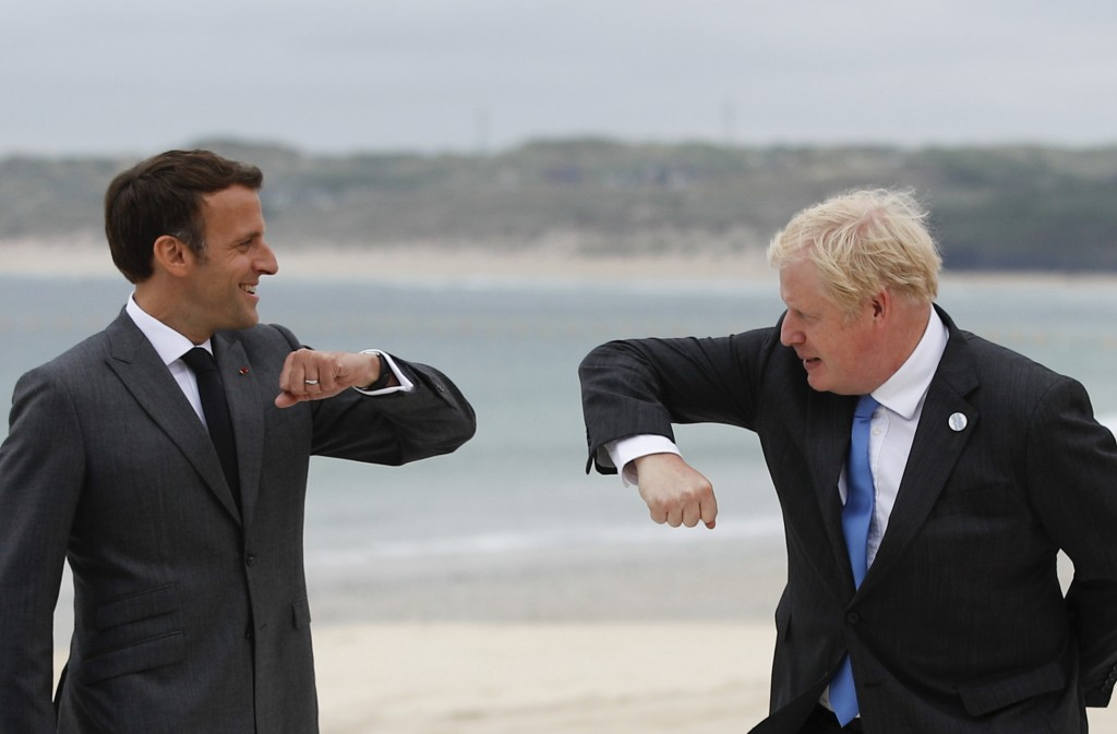 British Prime Minister Boris Johnson, right, greets French President Emmanuel Macron during arrivals for the G7 meeting at the Carbis Bay Hotel in Car...