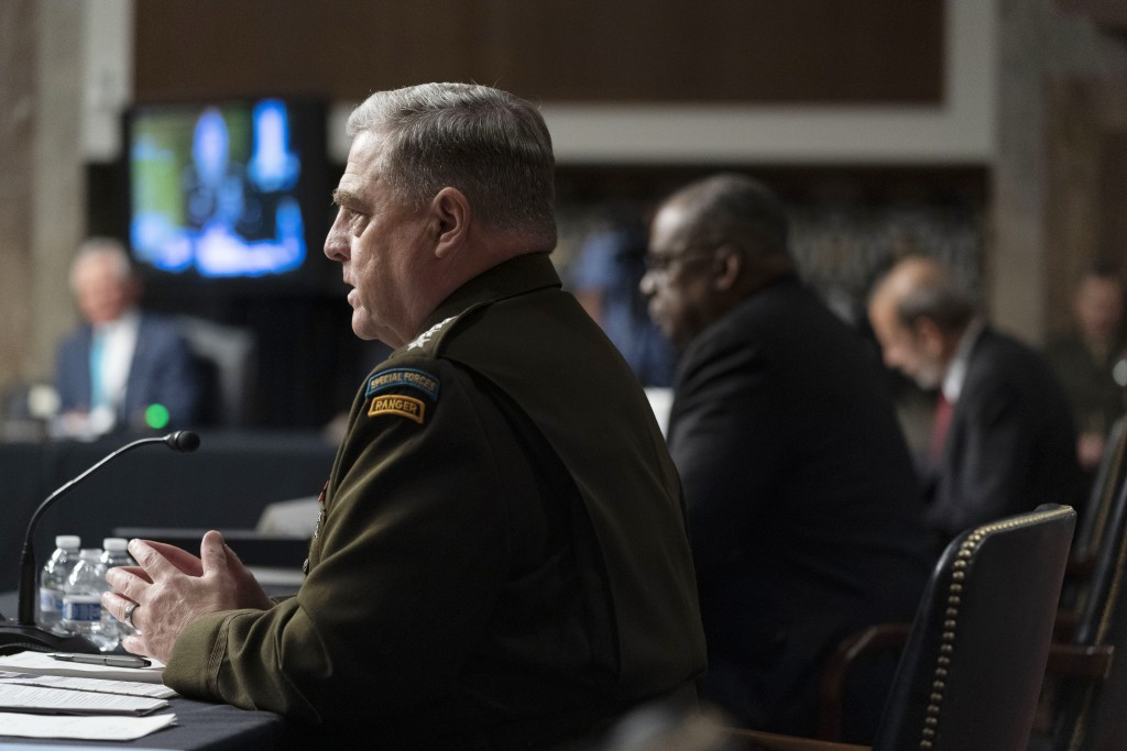 From left, Chairman of the Joint Chiefs of Staff Gen. Mark Milley, accompanied by Secretary of Defense Lloyd Austin, and Defense Under Secretary Mike ...