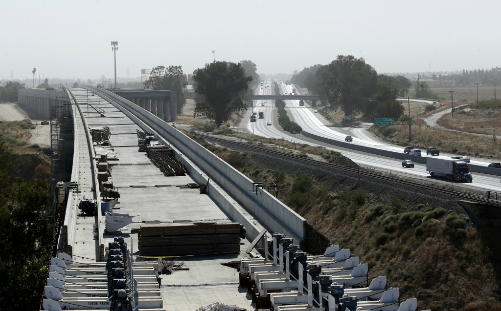 FILE - In this Oct. 9, 2019, file photo, is the high-speed rail viaduct paralleling Highway 99 near Fresno, Calif. The federal government has reached ...
