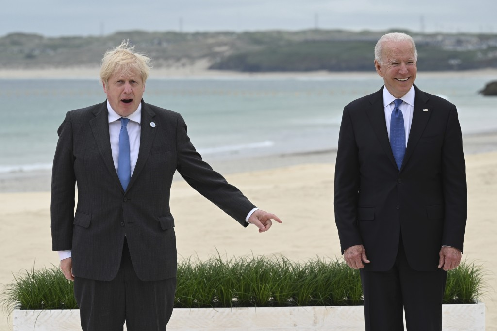Britain's Prime Minister Boris Johnson, left and US President Joe Biden pose, during the Leaders official welcome and group photo session, during the ...