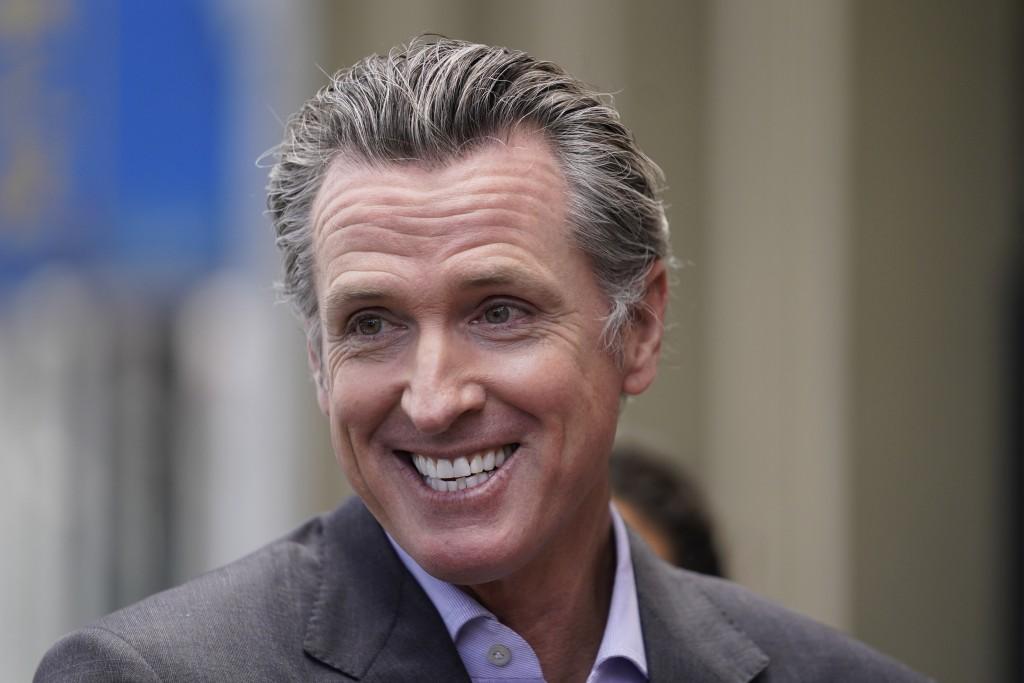 California Gov. Gavin Newsom smiles during a news conference in San Francisco, on Thursday,  June 3, 2021. California Gov. Gavin Newsom has signed an ...