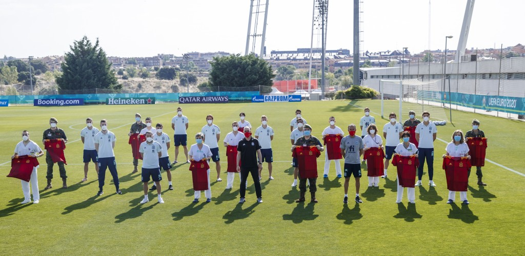 In this photo released by Spanish Soccer Federation (RFEF), Spain's national soccer team pose after being vaccinated against COVID at Las Rozas Sports...