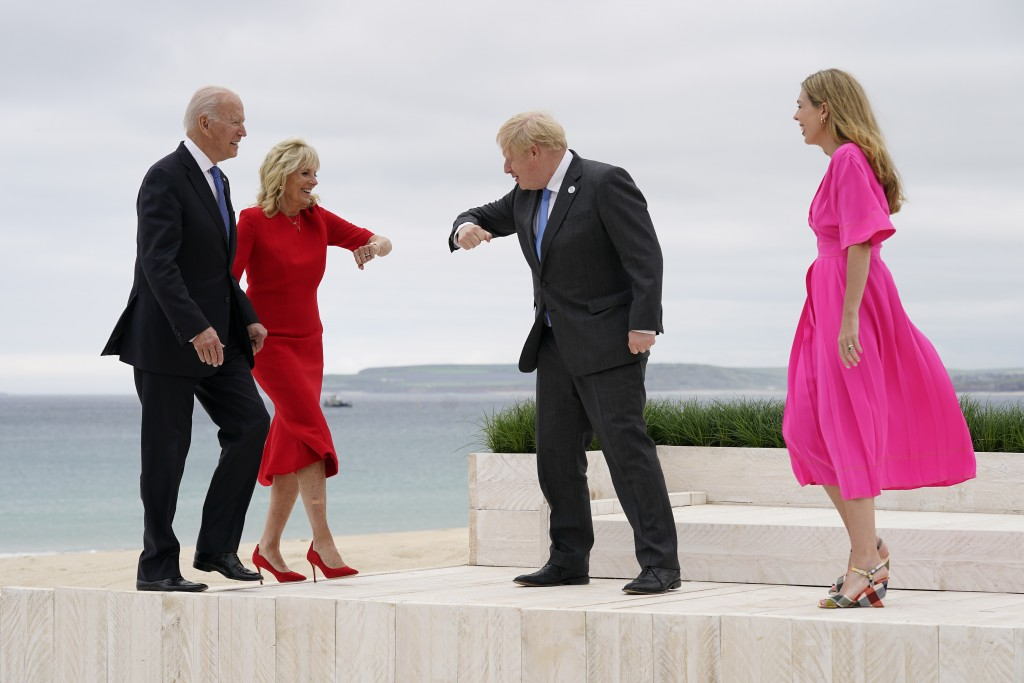 President Joe Biden and first lady Jill Biden are greeted by British Prime Minister Boris Johnson and his wife Carrie Johnson before posing for photos...