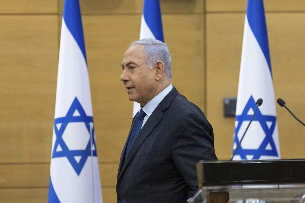FILE - In this May 30, 2021, file photo, Israeli Prime Minister Benjamin Netanyahu speaks to the Israeli Parliament in Jerusalem. If all goes accordin...