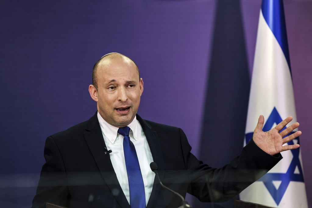 FILE - In this June 6, 2021, file photo, Naftali Bennett, Israeli parliament member from the Yamina party, gives a statement at the Knesset, Israel's ...