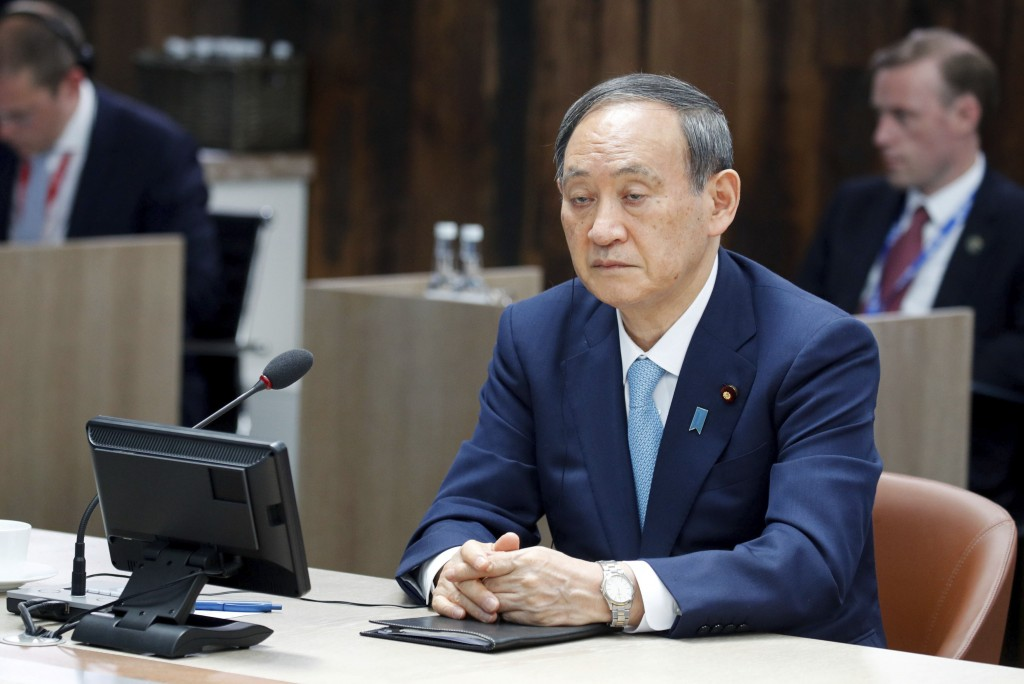 Japanese Prime Minister Yoshihide Suga attends a plenary session, during the G7 summit in Carbis Bay, England, Sunday June 13, 2021. (Phil Noble/Pool ...