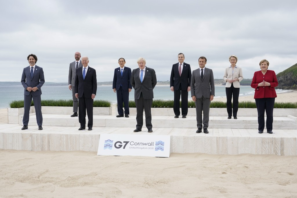 Leaders of the G7 pose for a group photo on overlooking the beach at the Carbis Bay Hotel in Carbis Bay, St. Ives, Cornwall, England, Friday, June 11,...