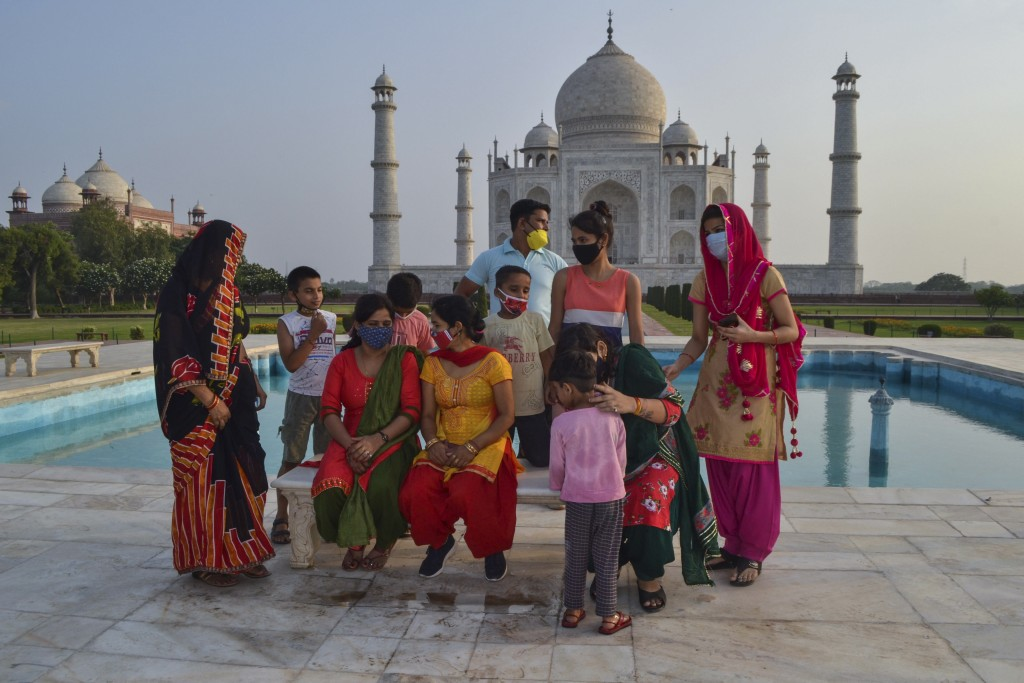 A group of Indians who visited the Taj Mahal monument that was Wednesday reopened to public after the lockdown to curb the spread of coronavirus gathe...