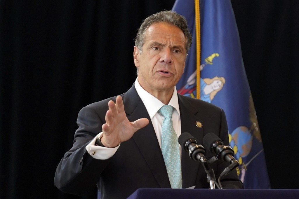 New York Gov. Andrew Cuomo speaks about the lifting of COVID-19 restrictions during a news conference at One World Trade in New York, Tuesday, June 15...