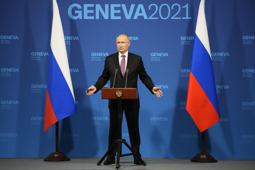 Russian President Vladimir Putin speaks during a news conference after his meeting with U.S President Joe Biden at the 'Villa la Grange' in Geneva, Sw...