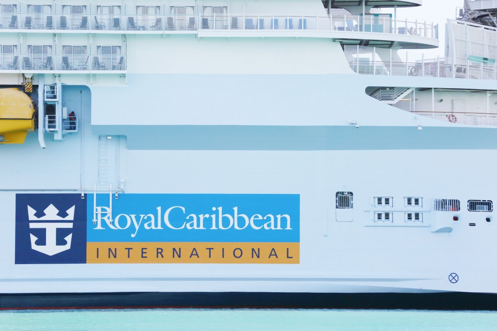 FILE - In this March 14, 2020 file photo, Royal Caribbean International cruise ship docked at PortMiami, among other cruise ships, as the world deals ...