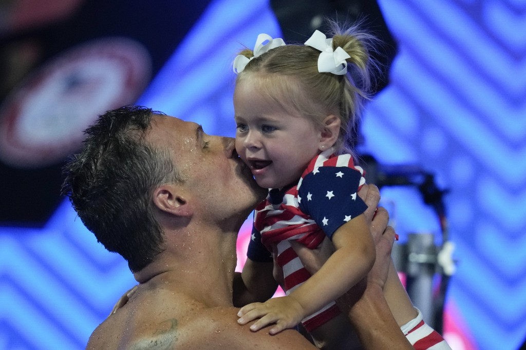 Ryan Lochte kisses his daughter after his heat in the men's 200 Individual Medley during wave 2 of the U.S. Olympic Swim Trials on Thursday, June 17, ...