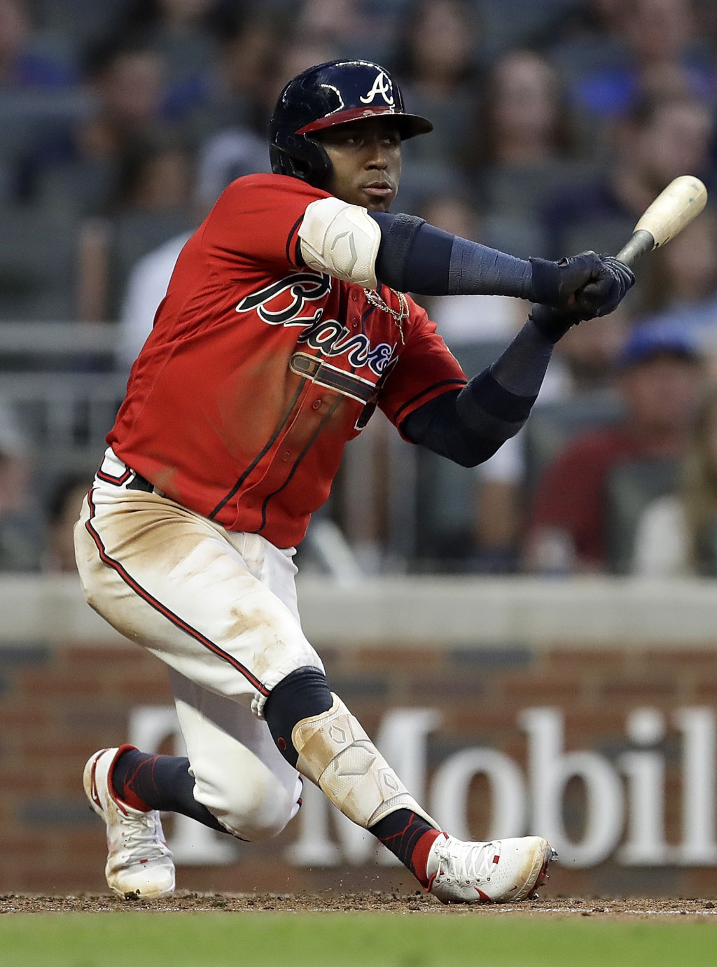 Atlanta Braves' Ozzie Albies swings for an RBI-double in the fourth inning of a baseball game against the St. Louis Cardinals, Friday, June 18, 2021, ...