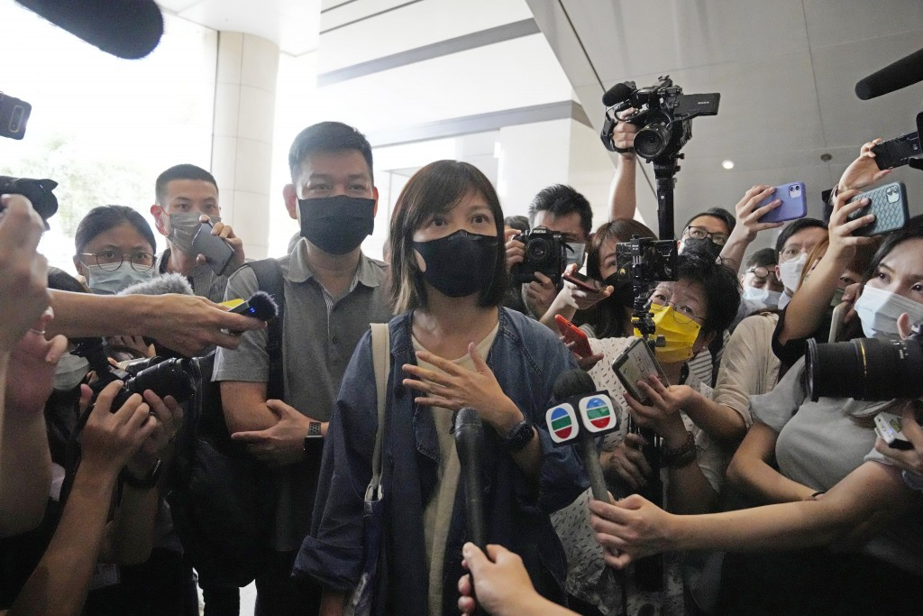 Chan Pui-man, deputy editor of the Apple Daily newspaper walks out from a court in Hong Kong, Saturday, June 19, 2021. A Hong Kong court ordered the t...