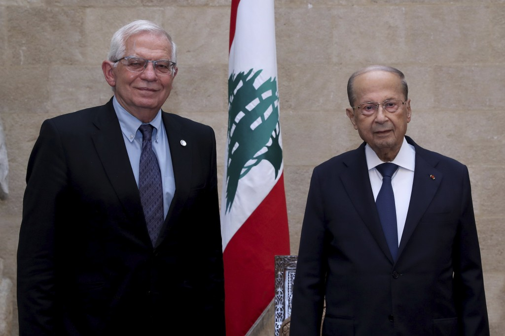In this photo released by Lebanese government, Lebanese President Michel Aoun, right, meets with European Union foreign policy chief Josep Borrell at ...