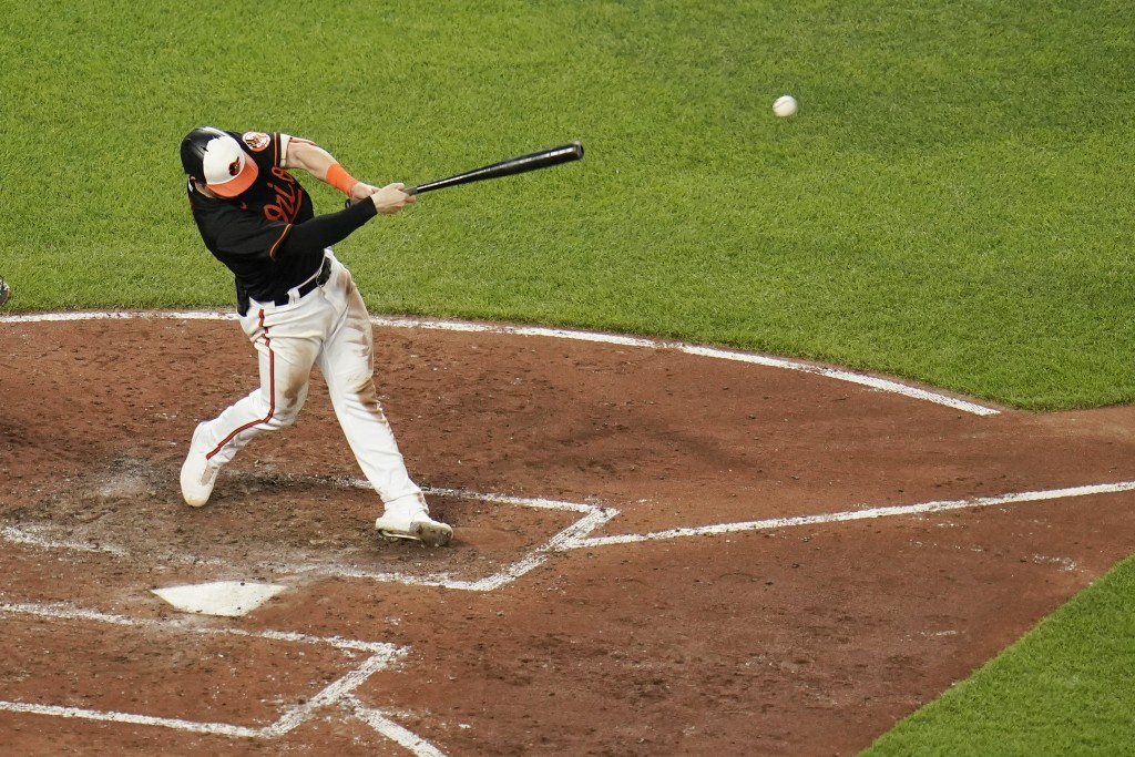 Baltimore Orioles' Austin Hays hits an RBI single to left field to score Pat Valaika during the fifth inning of a baseball game against the Toronto Bl...