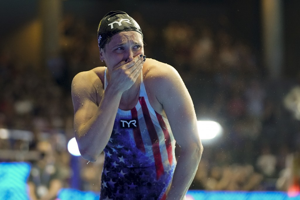 Annie Lazor reacts after winning the women's 200 breaststroke during wave 2 of the U.S. Olympic Swim Trials on Friday, June 18, 2021, in Omaha, Neb. (...