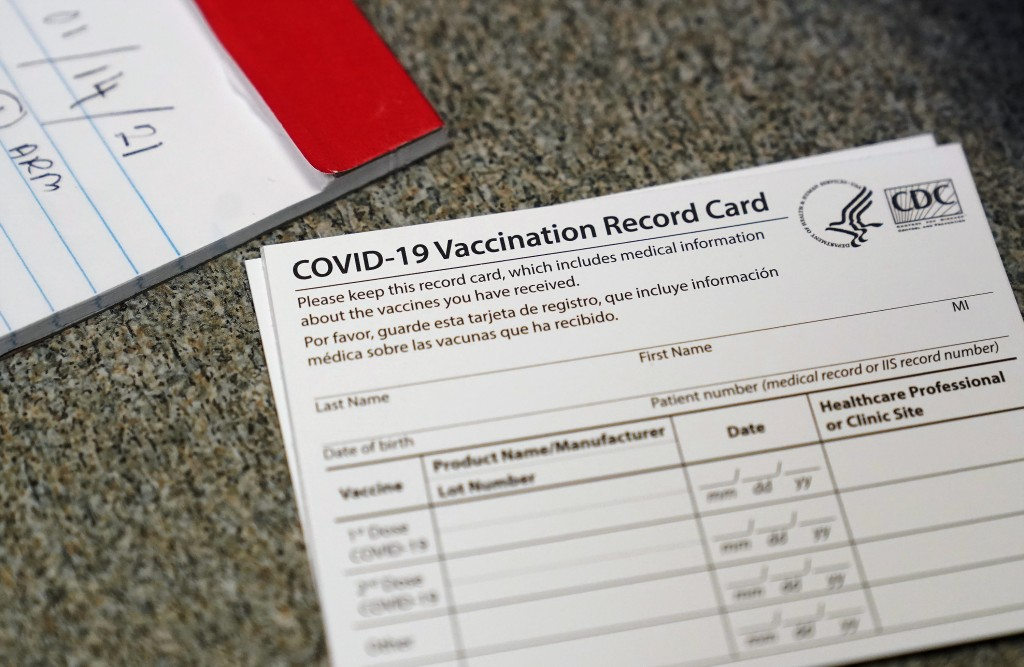 FILE - In this Dec. 24, 2020, file photo, a COVID-19 vaccination record card is shown at Seton Medical Center in Daly City, Calif. California is offer...